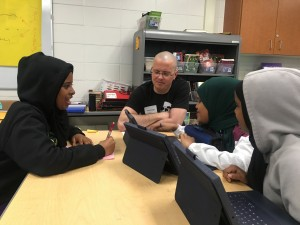 Monte works with Students as they brainstorm script ideas.