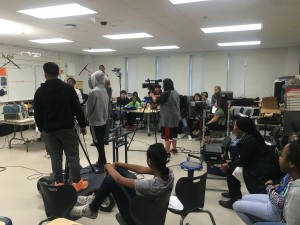 Blocking the scene in a well lit classroom